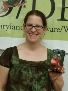 Kathy McMillan, MD/DE/WV SCBWI PAL Coordinator, with cover art/phone case of her upcoming debut book Sword and Verse
